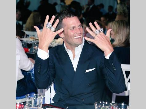 Superstar quarterback Tom Brady at Patriots XLIX Ring Ceremony wearing 4 SB rings before winning 5 in 2017. {Photo: patriots.com}